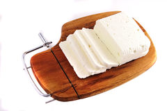 White goat cheese and slice on wooden plate Stock Image