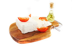 White goat cheese on wooden and sliced tomatoes stock photography