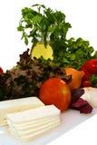 White goat feta cheese and fresh raw vegetables Royalty Free Stock Photos