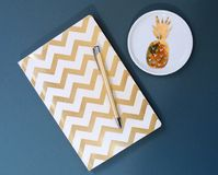 White and Gold Chevron Notebook Royalty Free Stock Photos