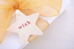 White Gold Christmas Gift with Wish Tag royalty free stock photo