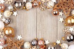 White and gold Christmas ornament frame on wood Royalty Free Stock Photos