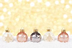 White and gold Christmas ornaments in snow Royalty Free Stock Photos