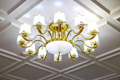 White and gold color crystal chandelier stock photo