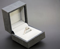 White gold and diamond engagement ring. In a black and white jewellery box Stock Photo