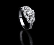 White gold diamond ring standing position Stock Photo