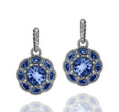 White gold earrings with blue sapphires and white diamonds Stock Photography