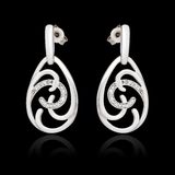 White gold earrings with diamond Stock Images
