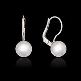 White gold earrings with pearl Royalty Free Stock Photos