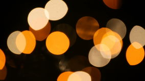 White and Gold Flashing Lights Loop. Video loop features bright white and golden soft-focused lights flashing against a dark background stock video