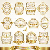 White gold-framed labels - vector set. Collection of various labels with decorative gold elements Stock Image