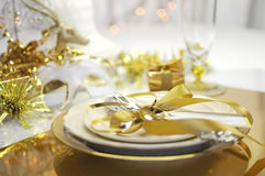 White and gold Happy New Year elegant fine dining table place setting. In gold theme Christmas and New Year decorations Royalty Free Stock Photos