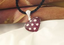 White Gold Heart Shaped Pendant With Rubies And Diamonds stock photography