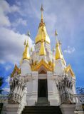 White and Gold Pagoda on Blue Sky at Khong Jiam Ubonratchatani,. White and Gold Pagoda on Blue Sky and Sunlight on the right of Picture at Khong Jiam Stock Photos