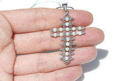 White gold pendant in the shape of a crucifix Royalty Free Stock Images