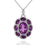 White gold pendant with violet amethyst and diamonds royalty free stock photo
