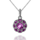 White gold pendant with violet amethysts and white diamonds. White gold pendant with violet amethysts and diamonds Royalty Free Stock Image
