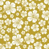 White on gold random hibiscus flower seamless repeat pattern background. Two colour random hibiscus flower seamless repeat pattern background. Could be used for Stock Photos