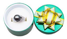 White gold ring with black pearl in open green box stock photos