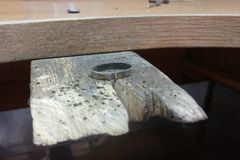 White gold ring blank lies on a wooden work surface. The process of making jewelry.  stock photography
