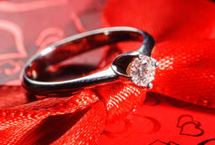 White gold ring on the red box Stock Photos