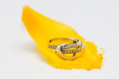 White gold ring on yellow tulip petal Stock Images