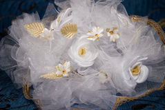 White and gold roses. Bridal bouquet from white artificial flowers royalty free stock images