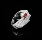 White gold ruby ring. Over black background Royalty Free Stock Photos