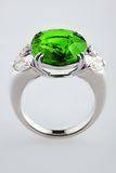 White gold or silver ring with green emerald Stock Photography