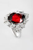 White gold or silver ring with red ruby gemstone Stock Image