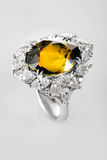 White gold or silver ring with yellow sapphire Royalty Free Stock Photography