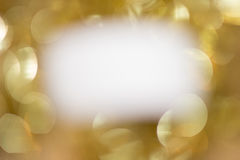 White on gold sparkles Stock Image