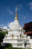 White and gold Stupa, Thailand. Traditional Buddhist stupa, white stone with golden statuettes.  Wat Chedi Luang temple, Chiang Mai, Thailand Stock Images