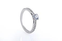White Gold Wedding, Engagement Rings with Diamonds. On white background stock photos