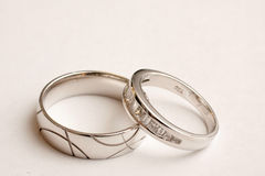 White Gold Wedding Rings. His and Hers wedding rings Stock Photos