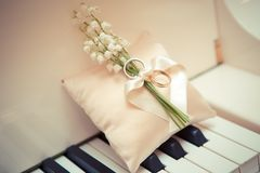 White gold wedding rings. With a bouquet of lily of the Valley Stock Photography