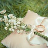White gold wedding rings with a bouquet Royalty Free Stock Photo