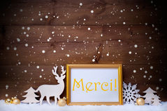 White And Golden Christmas Card, Snowflake, Merci Mean Thank You. Christmas Card With Picture Frame On White Snow. French Text Merci Means Thank You. White stock image