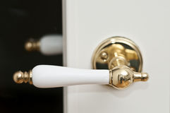 White and golden door handle Royalty Free Stock Image