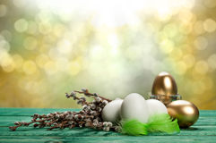 White and golden eggs Royalty Free Stock Images