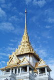 White and golden pagoda on blue sky background Royalty Free Stock Photos