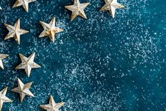 White golden stars on snowy dark blue background. Christmas New Year greeting card poster banner. Vintage retro style royalty free stock photos