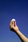White golf ball. Hand holding white golf ball Royalty Free Stock Photo
