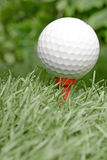 White golf ball on artificial turf Royalty Free Stock Photos