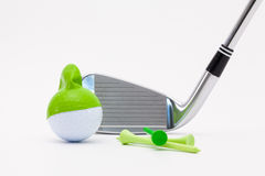 White golf ball with funny cap and golf club on the white backgr Stock Image