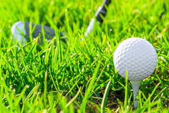 White golf ball on grass Royalty Free Stock Photos