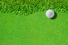 White golf ball on green grass background)