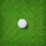 White golf ball on green grass of golf course. Stock Photography
