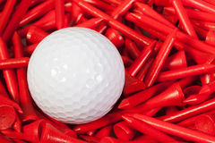 White golf ball lying between wooden tees Stock Images