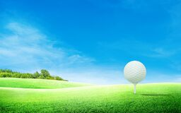 Free White Golf Ball On Tee And Green Grass Meadow Field With Blue Sky And Trees. Royalty Free Stock Photo - 185283915